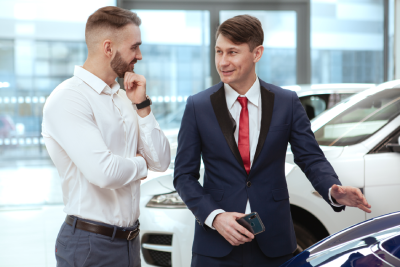 Young Businesman Buying New Automobile